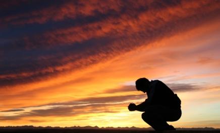 Praying under sunset