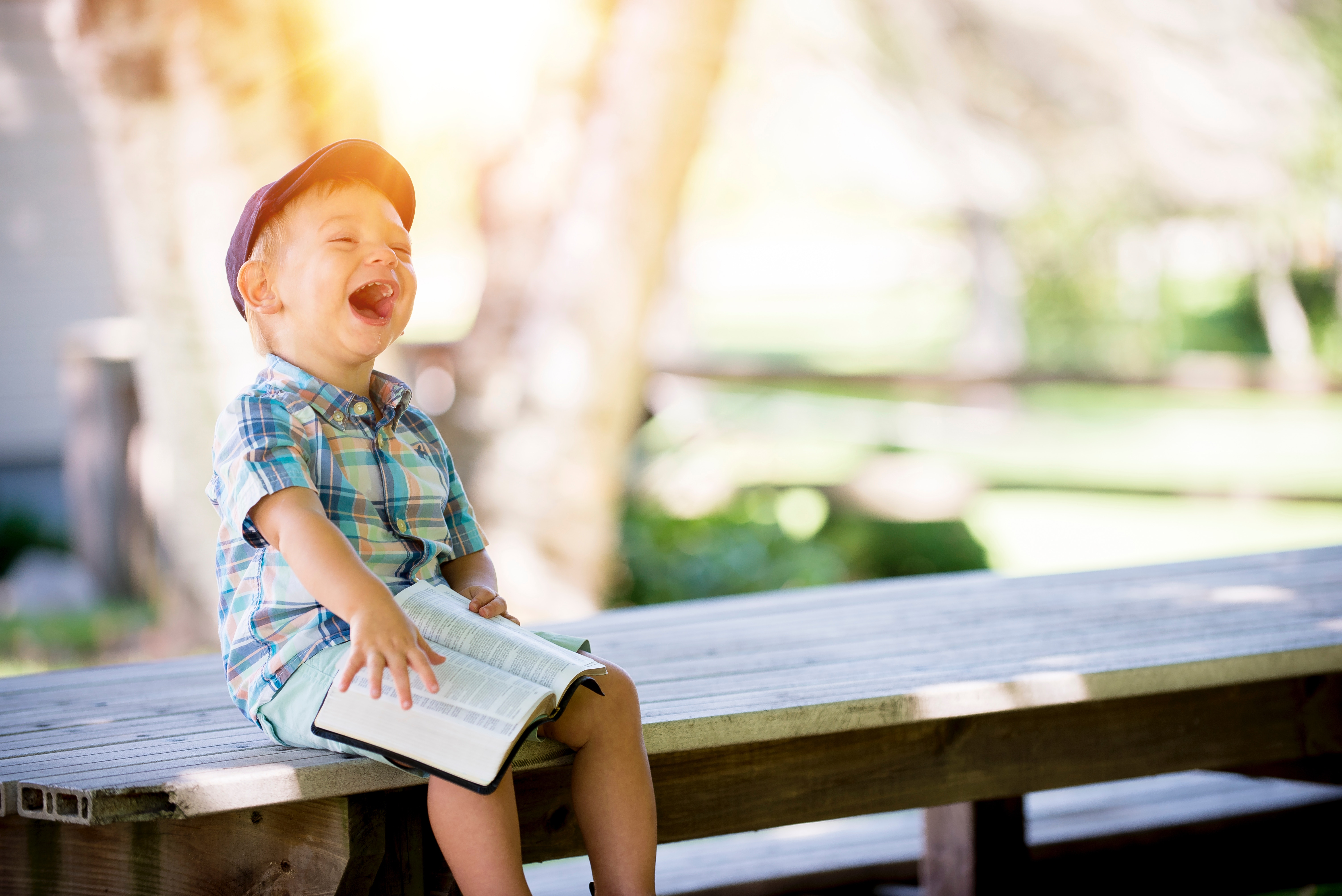laughing boy with bible